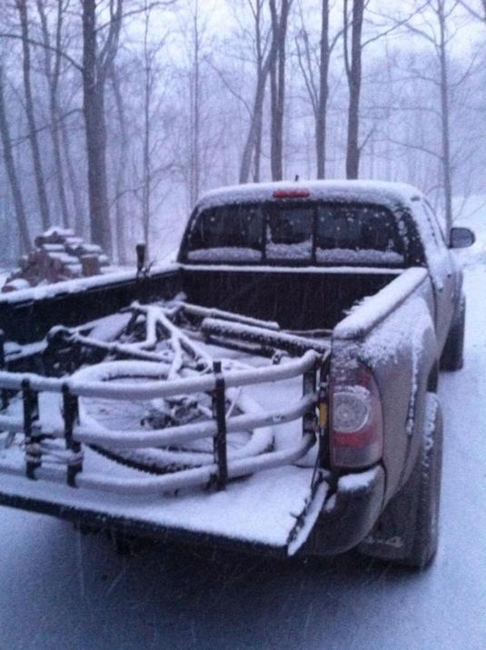 mountain bike in truck in snow