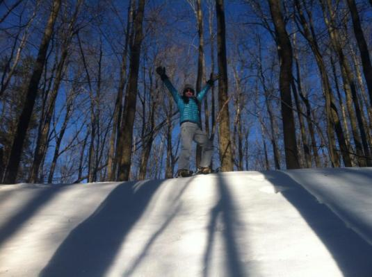 Snowshoes claim the top of the hill in triumph!
