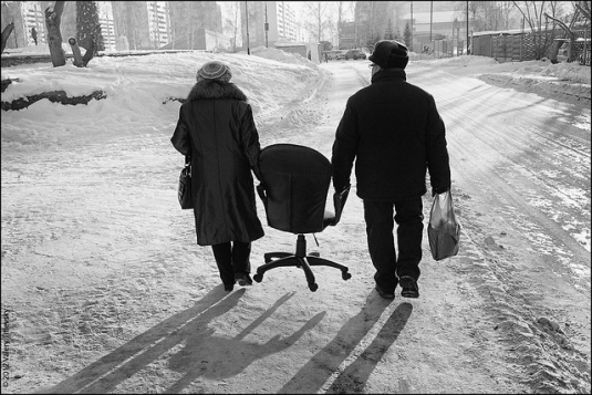 2 holding pocketbooks walking on ice sharing the weight keeping head warm furnishing home balancing load always returning home