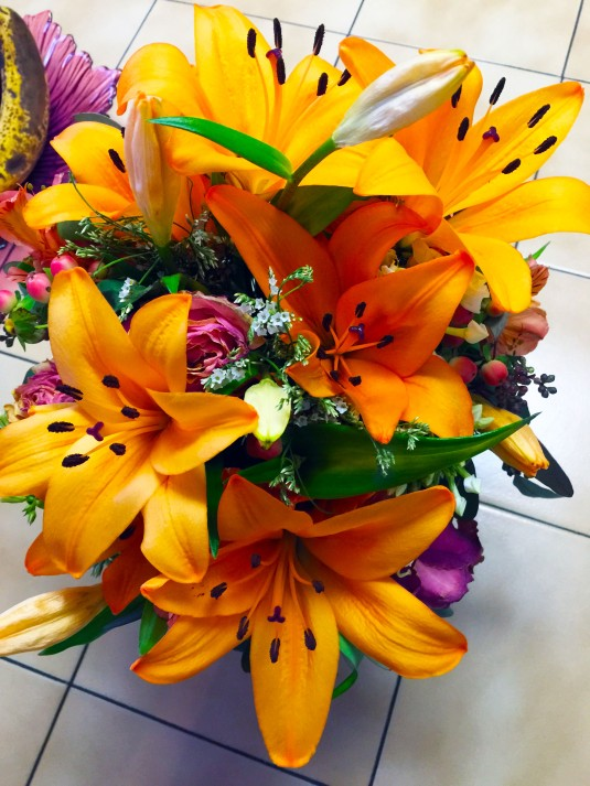 Birthday Flowers from my daughter Move from orange roses to orange tiger lilies in one week