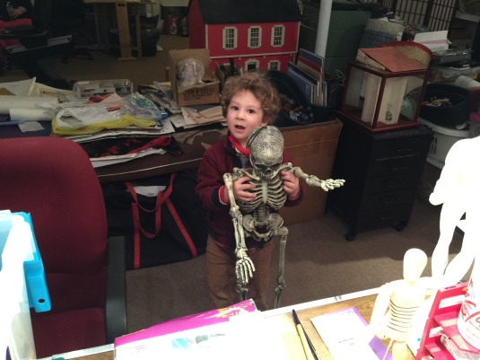 Oliver dances with the skeleton